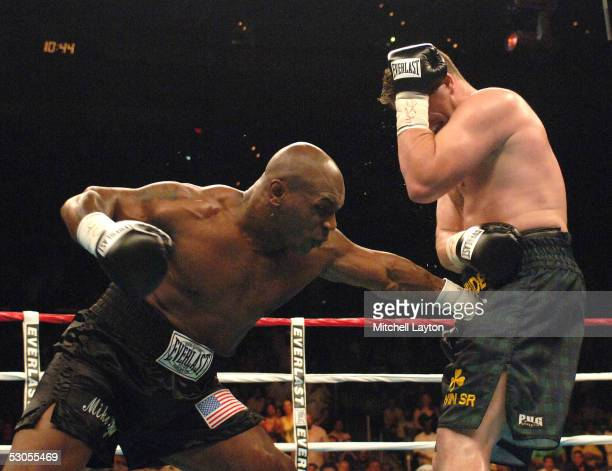 Mike Tyson connects to the groin area of Kevin McBride during their heavyweight bout at the MCI Center June 11 2005 in Washington DC McBride won by...