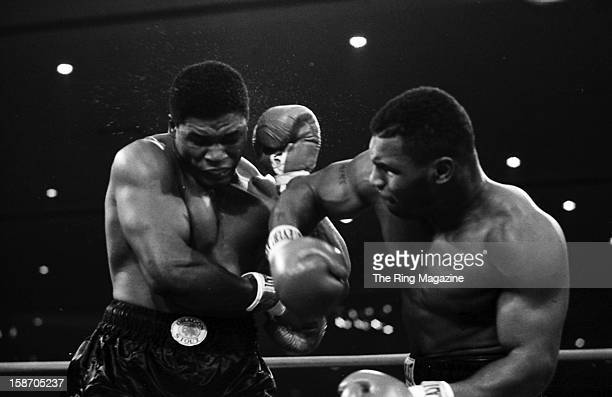 Mike Tyson connects with a right hook against Trevor Berbick during the bout at Las Vegas Hilton on November 22 1986 in Las Vegas Nevada Mike Tyson...