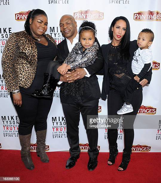 Mike Tyson daughters Mikey Tyson Milan Tyson wife Kiki Tyson and son Morocco Tyson arrive at the Los Angeles opening night of Mike Tyson Undisputed...