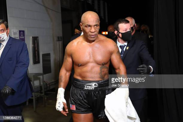 Mike Tyson exits the ring after receiving a split draw against Roy Jones Jr. During Mike Tyson vs Roy Jones Jr. Presented by Triller at Staples...