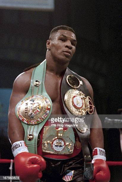 Mike Tyson gets ready for the fight against Tyrell Biggs at the Convention Hall on October 161987 in Atlantic City New Jersey Mike Tyson won the WBC...