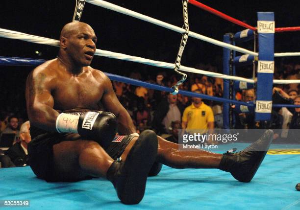 Mike Tyson hits the canvas after being knocked down by Kevin McBride during their heavyweight bout at the MCI Center June 11 2005 in Washington DC...
