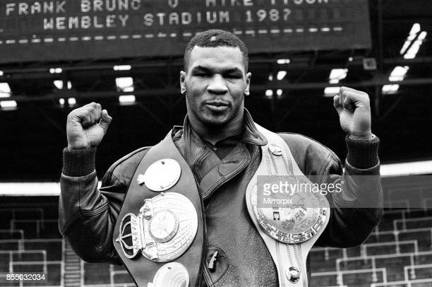 Mike Tyson in London to see Frank Bruno against James 'Quick ' Tillis Tyson at Wembley Stadium with the WBC WBA belts 22nd March 1987