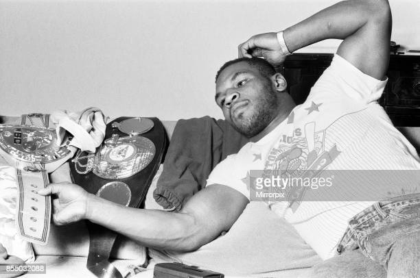 Mike Tyson in London to see Frank Bruno against James 'Quick ' Tillis Mike Tyson relaxing with his WBC WBA belts 25th March 1987