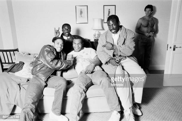 Mike Tyson in London to see Frank Bruno against James 'Quick ' Tillis Mike Tyson relaxing with his team 25th March 1987