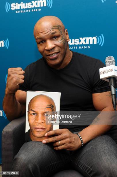 Mike Tyson is interviewed by Sirius XM host Sway Calloway on 'Sirius XM's Town Hall with Mike Tyson' at SiriusXM Studios on November 13 2013 in New...