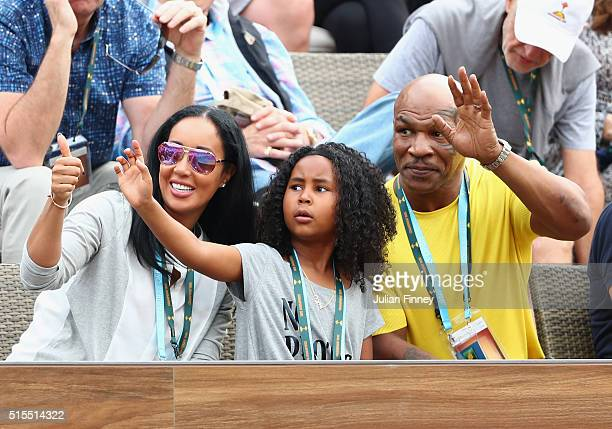 Mike Tyson Kiki Tyson and Milan Tyson watch Serena Williams of USA play during day seven of the BNP Paribas Open at Indian Wells Tennis Garden on...