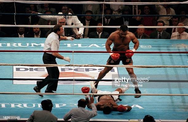 Mike Tyson knocks out Michael Spinks during the fight at the Convention Hall on June 27 1988 in Atlantic City New Jersey Mike Tyson won the WBC...