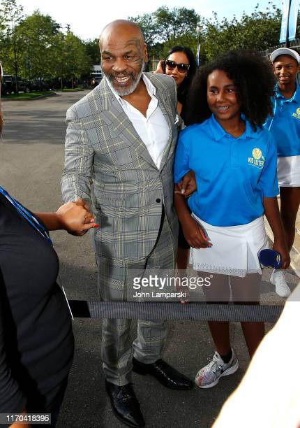 Mike Tyson Lakiha Spicer Wiki and daughter Milan Tyson attend USTA 19th Annual Opening Night Gala Blue Carpet at USTA Billie Jean King National...