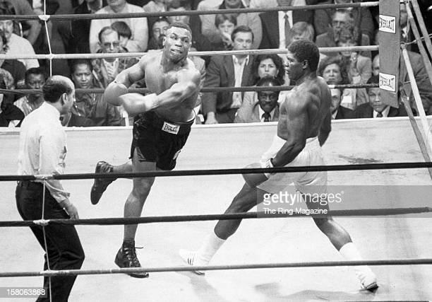 Mike Tyson leaps to throw a punch against James Tillis at the Civic Center, on May 3,1986 in Glens Falls, New York. Mike Tyson won by a UD 10.