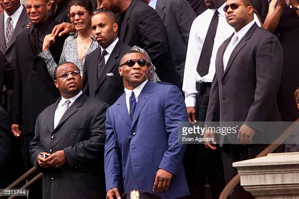 Mike Tyson leaving R B singer Aaliyah's memorial service at St Ignatius Loyola Roman Catholic Church in New York City 8/31/2001 Photo Evan...
