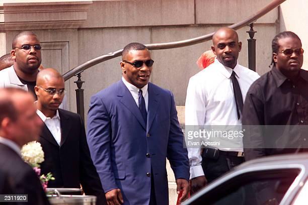 Mike Tyson leaving R B singer Aaliyah's memorial service at St Ignatius Loyola Roman Catholic Church in New York City 8/31/2001 Photo Evan...