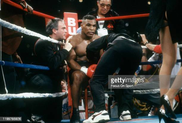 Mike Tyson looks on from his corner during the WBC WBA and IBF Heavyweight title fight against Frank Bruno on February 25 1989 at the Las Vegas...