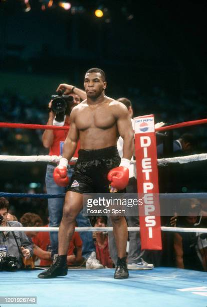 Mike Tyson looks on from his corner prior to the start of the WBC, WBA and Ring Heavyweight title fight against Michael Spinks on June 27, 1988 at...