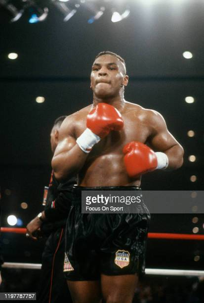 Mike Tyson looks on prior to the start of a heavyweight fight against Trevor Berbick on November 22, 1986 at the Las Vegas Hilton in Las Vegas,...