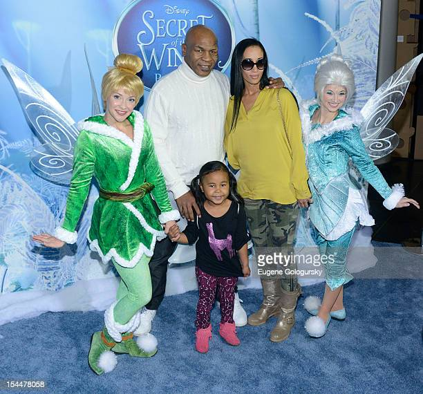 Mike Tyson Milan Tyson Kiki Tyson attend Secret Of Wings New York Premiere at AMC Loews Lincoln Square on October 20 2012 in New York City