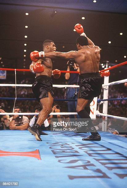 Mike Tyson moves to punch against Trevor Berbick during a bout at the Hilton on November 22 1986 in Las Vegas Nevada Tyson won the bout with a TKO in...