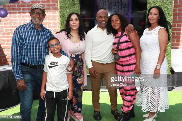 """Mike Tyson poses with his father-in-law, Shamsud din Ali, son Morocco, mother-in-law Rita Ali, wife Lakiha """"Kiki"""" Spicer and daughter Milan Tyson..."""
