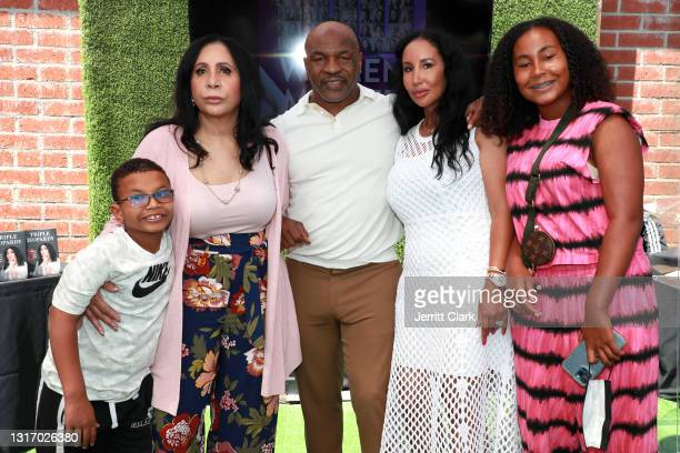 """Mike Tyson poses with his son Morocco, mother-in-law Rita Ali, wife Lakiha """"Kiki"""" Spicer and daughter Milan Tyson attend the 100 Women Matter..."""