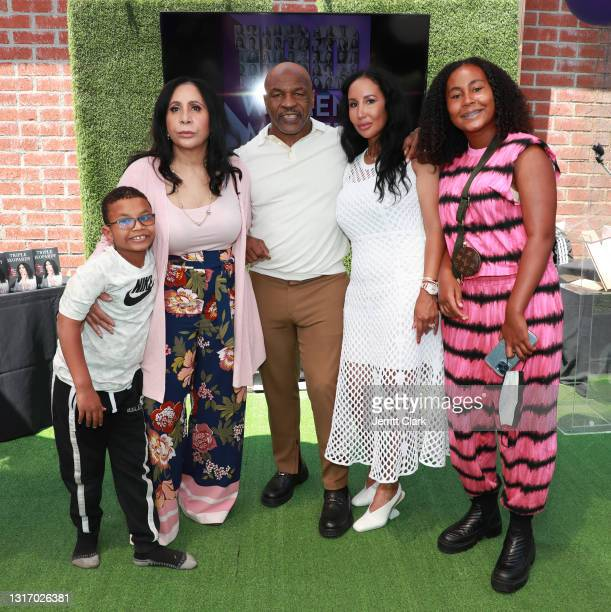 """Mike Tyson poses with his son Morocco, mother-in-law Rita Ali, wife Lakiha """"Kiki"""" Spicer and daughter Milan Tyson at the 100 Women Matter Luncheon..."""