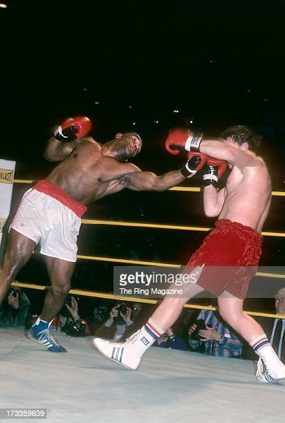 Mike Tyson reaches to land a punch against Steve Zouski during the fight at Nassau Coliseum in Uniondale New York Mike Tyson won by a KO 3