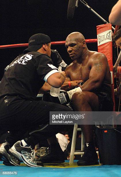 Mike Tyson receives instructions in his corner during his heavyweight bout against Kevin McBride at the MCI Center June 11 2005 in Washington DC