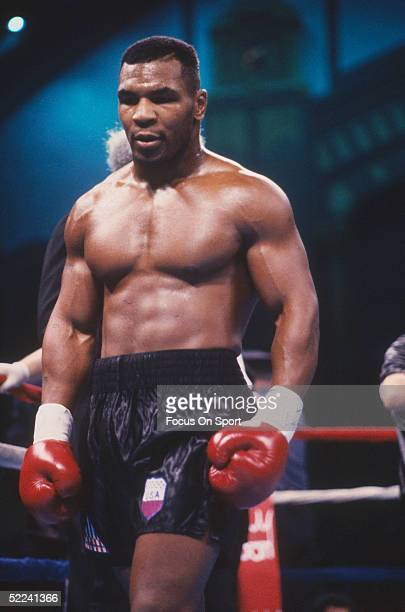 Mike Tyson stands during a fight in the ring.