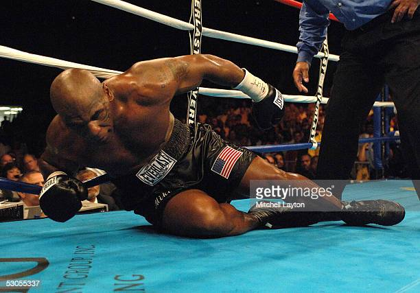 Mike Tyson struggles to get off the canvas after being knocked down by Kevin McBride during their heavyweight bout at the MCI Center June 11 2005 in...