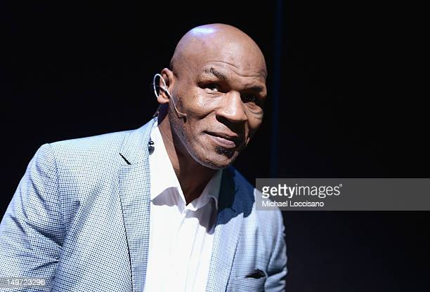 Mike Tyson takes part in a curtain call following his 'Mike Tyson Undisputed Truth' Broadway Opening Night at Longacre Theatre on August 2 2012 in...