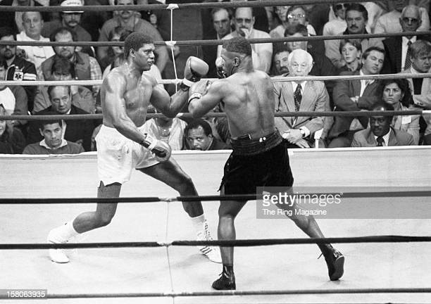 Mike Tyson throws a punch against James Tillis during the fight at the Civic Centeron May 31986 in Glens Falls New York Mike Tyson won by a UD 10