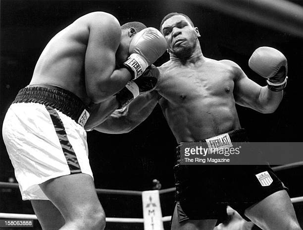 Mike Tyson throws a punch against Reggie Gross during the fight at the Madison Square Garden, on June 13,1986 in New York, New York. Mike Tyson won...