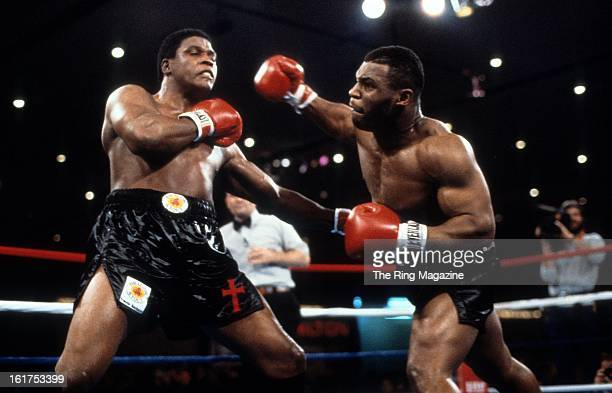 Mike Tyson throws a punch against Trevor Berbick during the fight at Hilton Hotel in Las Vegas Nevada Mike Tyson won the WBC heavyweight title by a...
