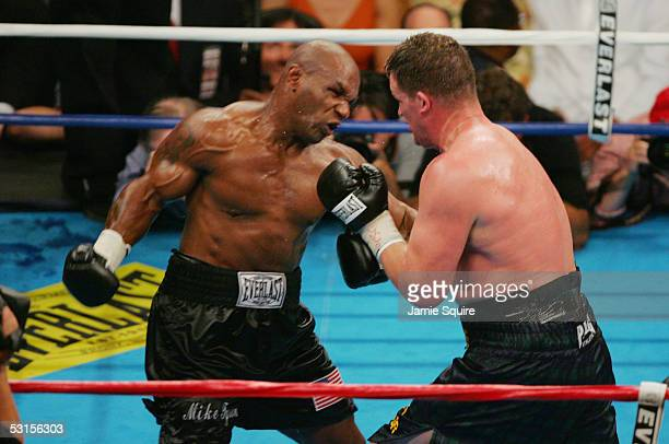 Mike Tyson throws a punch at Kevin McBride during their heavyweight bout on June 11 2005 at the MCI Center in Washington DC McBride was declared...