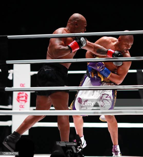 Mike Tyson throws a punch in the third round against Roy Jones Jr. During Mike Tyson vs Roy Jones Jr. Presented by Triller at Staples Center on...