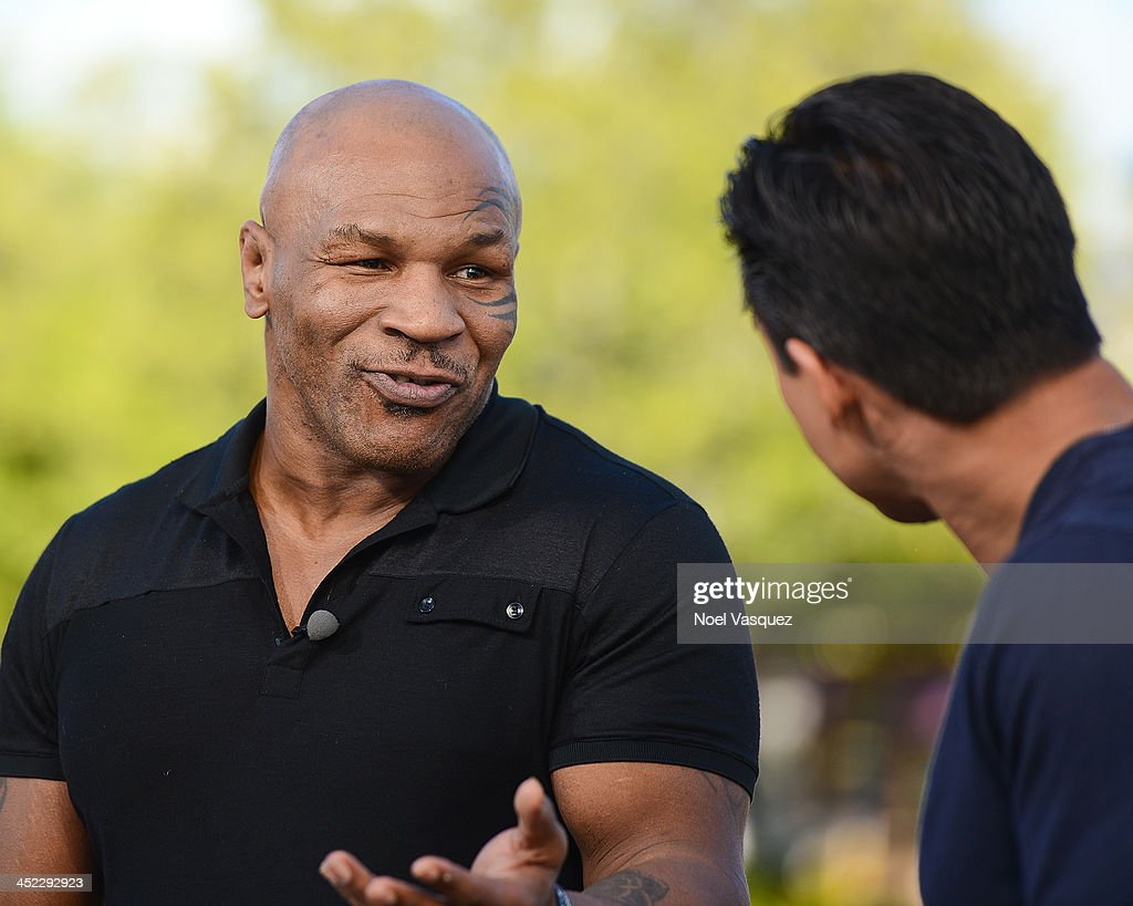Mike Tyson visits 'Extra' at Universal Studios Hollywood on November 27, 2013 in Universal City, California.