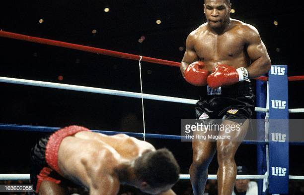 Mike Tyson watches Alfonzo Ratliff on the canvas during the fight at the Hilton Hotel in Las Vegas Nevada Mike Tyson won by a TKO 2