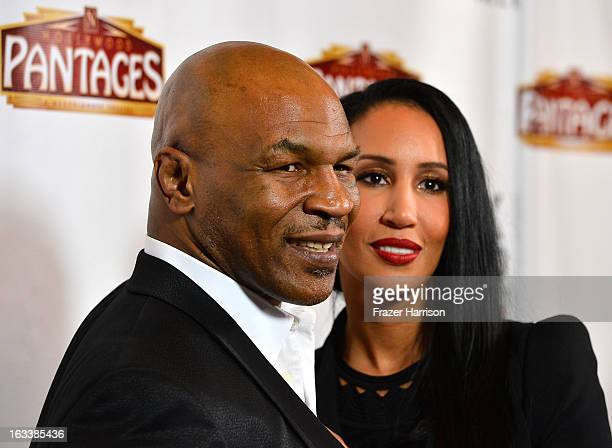 """Mike Tyson with his wife Kiki Tyson arrive at the opening Night Of """"Mike Tyson: Undisputed Truth"""" At The Pantages Theatre at the Pantages Theatre on..."""