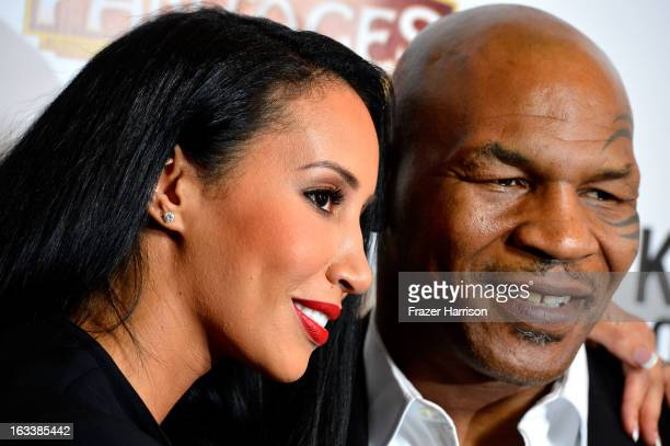 Mike Tyson with his wife Kiki Tyson arrive at the opening Night Of Mike Tyson Undisputed Truth At The Pantages Theatre at the Pantages Theatre on...