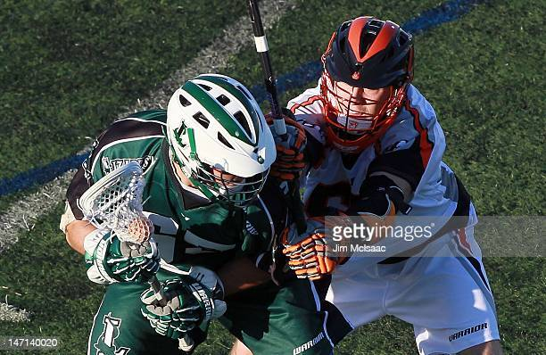 Mike Unterstein of the Long Island Lizards in action against Peet Poillon of the Denver Outlaws during their Major League Lacrosse game on June 23...