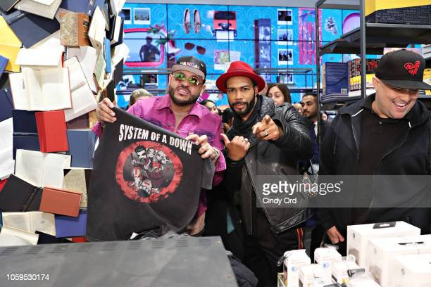 Mike Upscale Vandal Camargo and actor Omari Hardwick attend as Bloomingdale's celebrates The Carousel Past Made Present on November 8 2018 in New...