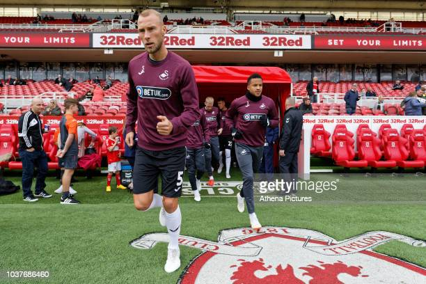 Mike van and Martin Olsson of Swansea City exit the tunnel during the Sky Bet Championship match between Middlesbrough and Swansea City at the...