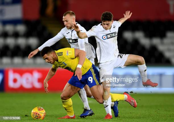 Mike Van der Hoorn and Daniel James of Swansea City attempts to tackle Che Adams of Birmingham City during the Sky Bet Championship match between...