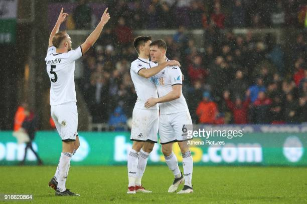 Mike van der Hoorn and Federico Fernandez and Alfie Mawson of Swansea City after the final whistle of the Premier League match between Swansea City...