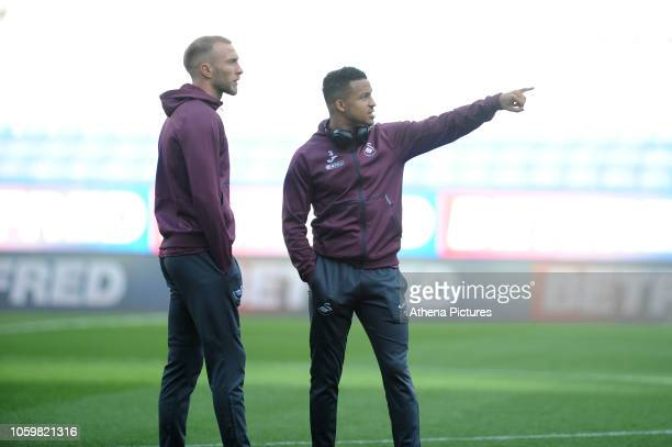 Mike van der Hoorn and Martin Olsson of Swansea City arrive for during the Sky Bet Championship match between Bolton Wanderers and Swansea City at...