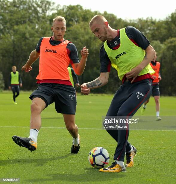Mike van der Hoorn and Oliver McBurnie in action during the Swansea City Training and Press Conference at The Fairwood Training Ground on August 24...