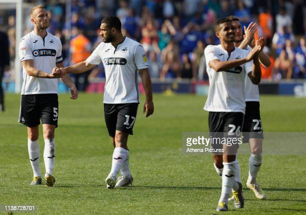 Mike van der Hoorn Cameron CarterVickers and Kyle Naughton of Swansea City thank away supporters after the final whistle during the Sky Bet...
