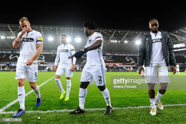 Mike van der Hoorn Martin Olsson Wilfried Bony and Leroy Fer of Swansea City look dejected at full time during the Sky Bet Championship match between...