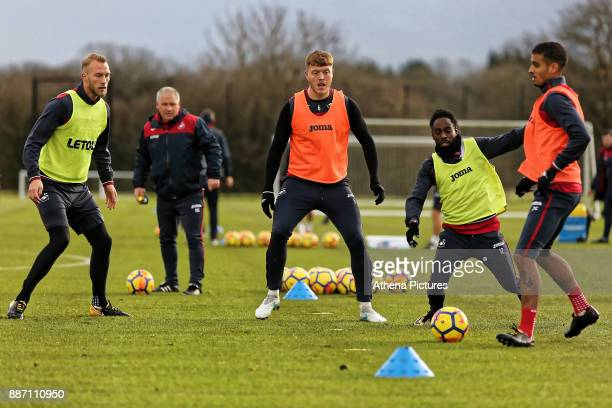 Mike van der Hoorn Nigel Gibbs Swansea City Assistant manager Alfie Mawson Nathan Dyer and Kyle Naughton in action during the Swansea City Training...