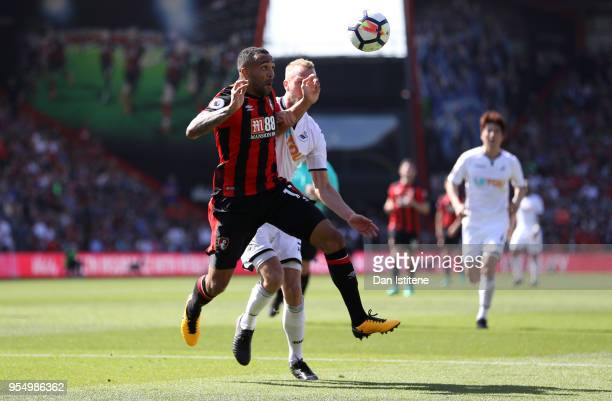 Mike van der Hoorn of Swansea City challenges Callum Wilson of AFC Bournemouth in the box during the Premier League match between AFC Bournemouth and...