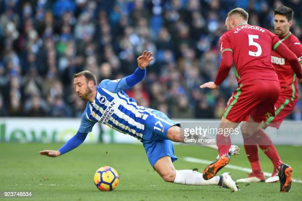 Mike van der Hoorn of Swansea City fouls Glenn Murray of Brighton and Hove Albion leading to a penalty during the Premier League match between...